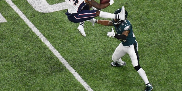 New England Patriots wide receiver Brandin Cooks attempts to hurdle Philadelphia Eagles free safety Rodney McLeod in the first half in Super Bowl LII.