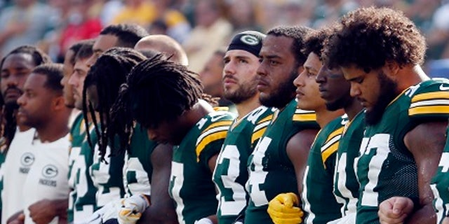 Green Bay Packers players linked arms Sunday during the national anthem.