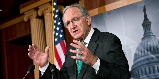 Sen. Tom Harkin, D-Iowa, chairman of the Health, Education, Labor, and Pensions Committee, talks to reporters after the Senate cleared a major hurdle and agreed to proceed to debate a bill that would prohibit workplace discrimination against gay, bisexual and transgender Americans, at the Capitol in Washington, Monday, Nov. 4, 2013. The bipartisan vote increases the chances that the Senate will pass the bill by week's end, but its prospects in the Republican-led House are dimmer. (AP Photo/J. Scott Applewhite)
