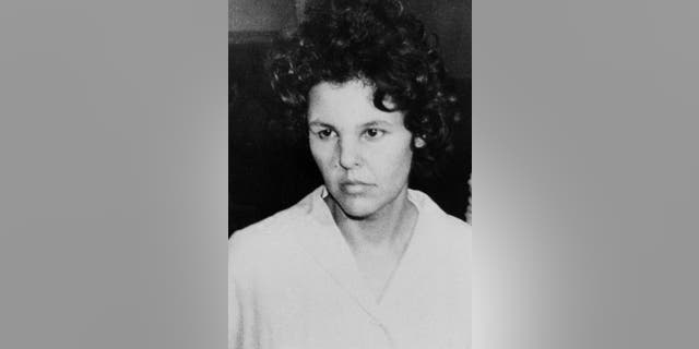 FILE - In this Oct. 21, 1981 file photo, Judith Clark is taken into police custody in Nanuet, N.Y. On Friday, April 21, 2017, New York's Parole Board has denied Clark parole. The former Weather Underground radical drove a getaway car in the1981 Brinks armored car robbery that left three people dead. She has served 35 years of a 75-years-to-life sentence. (AP Photo/David Handschuh, File)