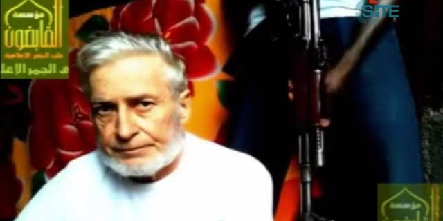 This image taken from a video released by the SITE Intelligence Group shows French enginner Francis Collomp, who is being held hostage by the Nigeria-based Ansar al-Muslimeen.