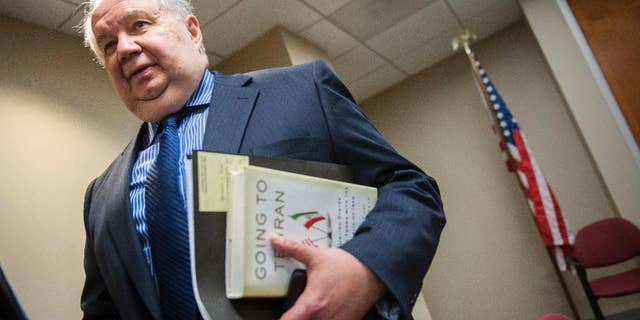FILE - In this Sept. 6, 2013 file photo, Russia's ambassador to the U.S. Sergey Kislyak, speaks with reporters in Washington. (AP Photo/Cliff Owen, File)