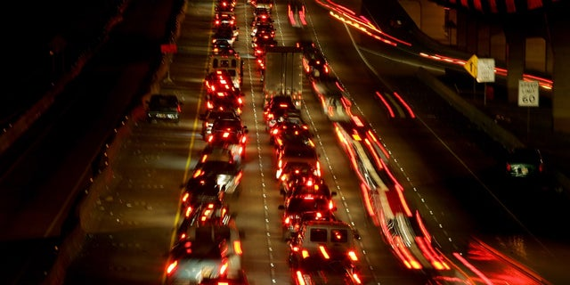 Thousands of cars try to evacuate to Dallas in advance of Hurricane Rita in north Houston September 22, 2005. Hurricane Rita weakened to a still dangerous Category 4 storm with maximum sustained winds of 150 miles per hour, the U.S. National Hurricane Center said in an advisory on Thursday. REUTERS/Carlos Barria - RTRP3OS