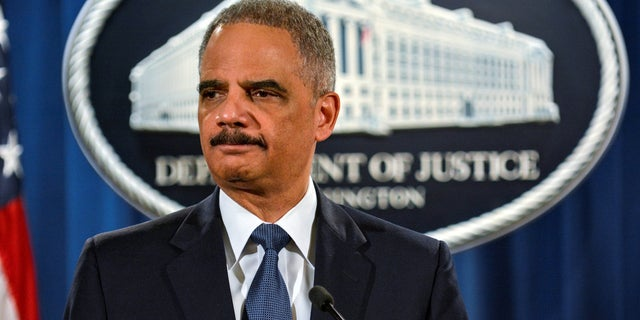 """Trump praised former Attorney General Eric Holder telling The New York Times that he """"totally protected"""" former President Obama."""