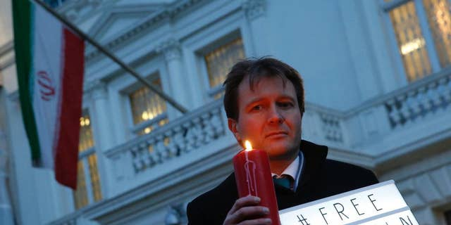 FILE -- In this Jan. 16, 2017 file photo, Richard Ratcliffe, husband of imprisoned charity worker Nazanin Zaghari-Ratcliffe, poses for the media during an Amnesty International led vigil outside the Iranian Embassy in London.