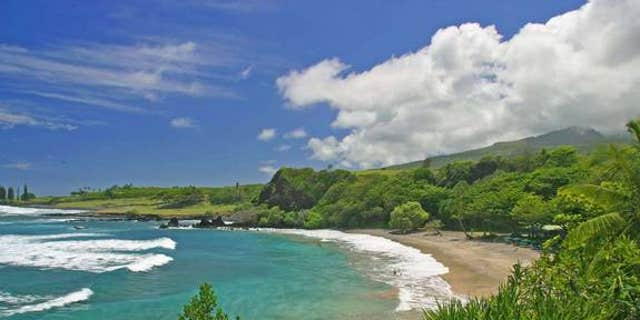Hamoa Beach in Maui. Fantasizing about a beach vacation may make someone inclined to ignore the negative considerations while gathering information about it, research indicates.