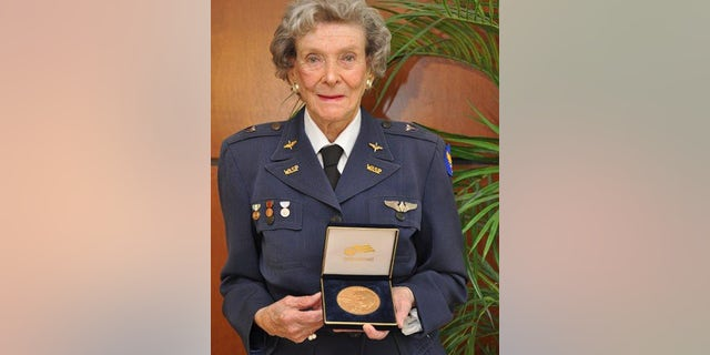 Bernice Haydu pictured with the Congressional Gold Medal.