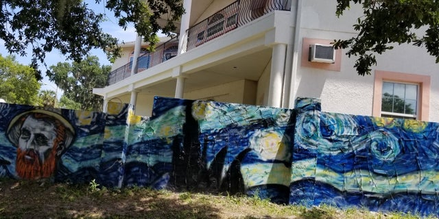 """The couple first commissioned the rendition of """"Starry Night"""" for the 40-foot-wall (above) in front of their home. But before the wall was even finished, the city sent the homeowners a graffiti notice and ordered that the wall and house must match. After the citation, the owners had the artist paint their entire house in the same theme of the Dutch master's 1889 masterpiece."""