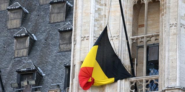 A Belgian flag flies at half-mast following bomb attacks s in Brussels, Belgium, March 22, 2016.(REUTERS/Charles Platiau)