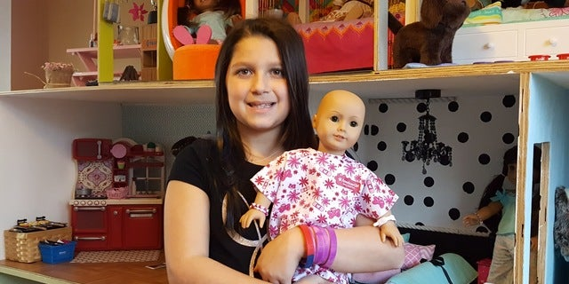 Bella Fricker has been raising money to donate dolls to young cancer patients.