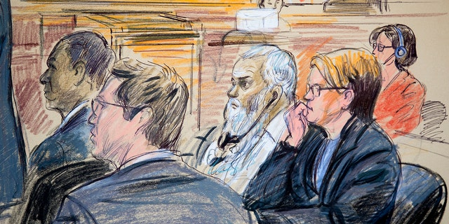 This courtroom sketch shows Ahmed Abu Khattala, third from right, listening to an interpreter through earphones during the opening statement by his defense attorney Jeffery Robinson in federal court in Washington Monday, Oct. 2, 2017.