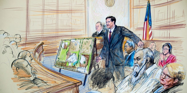 This courtroom sketch depicts Ahmed Abu Khattala listening to a interpreter through earphones during the opening statement by assistant U.S. attorney John Crabb, second from left, at federal court in Washington in the trial presided by U.S. District Judge Christopher Cooper, Monday, Oct. 2, 2017.