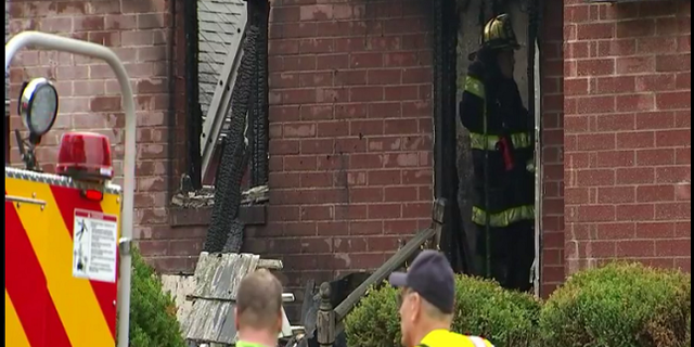 Firefighters on the scene of the fire at a Bensalem home that killed a pet owner trying to rescue her animals. (Fox)