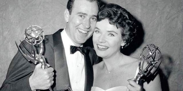 Writer Carl Reiner and singer Polly Bergen poise with their Emmy Awards statuettes on April 15, 1958, in New York City.