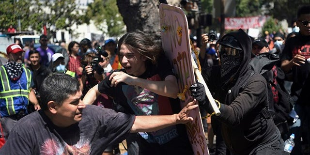 In this Aug. 27, 2017 file photo, demonstrators clash during a free speech rally in Berkeley, Calif. Police in Berkeley, California say they need an additional weapon to combat violent protests that have repeatedly hit the city.