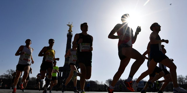 Participants run during the half marathon event in Berlin, Sunday, April 8, 2018.