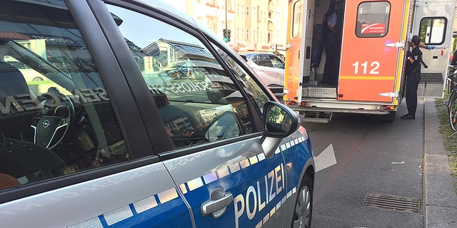 Two homeless men were set on fire by an unknown assailant at a Berlin railway station, police said.