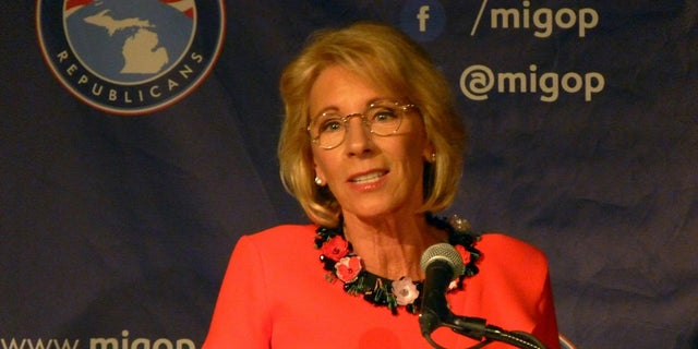 Harvard University students protested Education Secretary Betsy DeVos' visit to the campus.