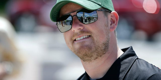 NASCAR driver Justin Allgaier looks on during a promotion for the DuPont Pioneer 250 NASCAR Nationwide Series on May 20, 2013, in Des Moines, Iowa. (AP Photo/Charlie Neibergall)