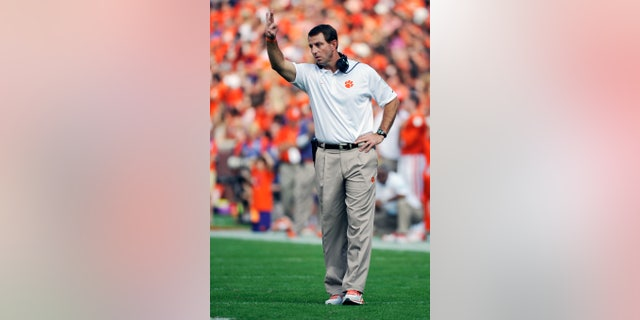 Clemson head coach Dabo Swinney gestures to his players during the first half of an NCAA college football game against Wake Forest, Saturday, Sept. 28, 2013, in Clemson, S.C. (AP Photo/Rainier Ehrhardt)