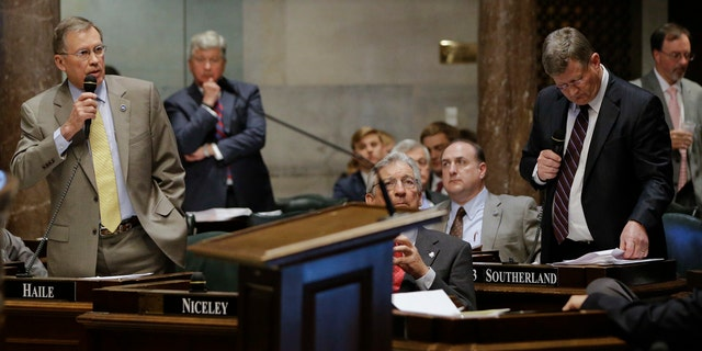 April 4, 2016: Sen. Ferrell Haile, R-Gallatin, left, speaks during debate on a bill by Sen. Steve Southerland, R-Morristown, front right, to make the Holy Bible the official book of Tennessee.