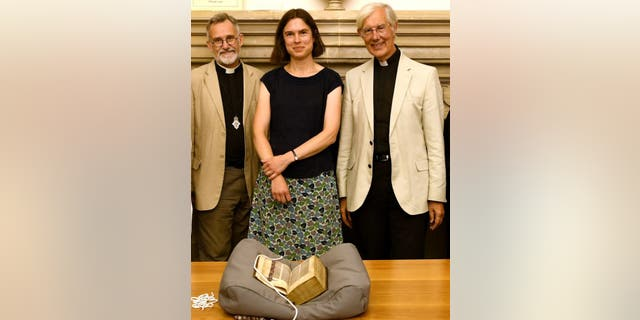 The Lyghfield Bible with (left to right) Canon Librarian, Revd Tim Naish, Head of Archives and Library Cressida Williams and the Dean of Canterbury, the Very Revd Robert Willis. (Canterbury Cathedral)