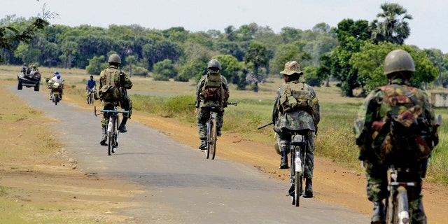 File photo - Special Task Force soldiers on bicycles patrol near Vellavely village in Sri Lanka, which was territory formerly controlled by the Tamil Tiger rebels, in Batticaloa May 28, 2007. (REUTERS/Buddhika Weerasinghe)