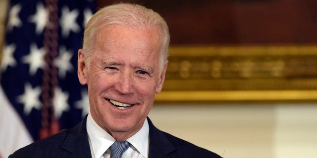 Vice President Joe Biden smiling in the State Dining Room of the White House in January 2017.