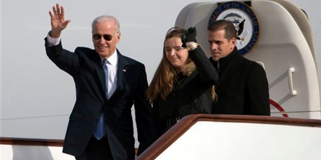 Dec. 4, 2013: Vice President Joe Biden, left, waves as he walks out of Air Force Two with his granddaughter Finnegan Biden and son Hunter Biden at the airport in Beijing. (Associated Press)