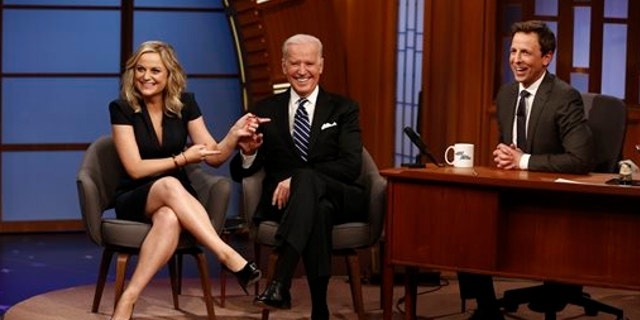 """Feb. 24, 2014: In this photo provided by NBC, from left, actress Amy Poehler and Vice President Joe Biden appear with host Seth Meyers on the premiere of """"Late Night with Seth Meyers"""" in New York."""