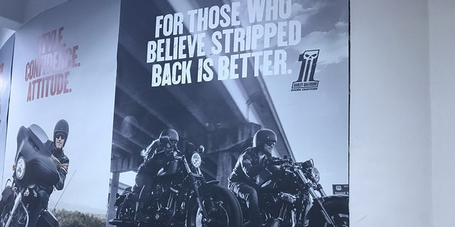 Marketing materials featuring women adorn the walls of the Harley Davidson dealership in Riyadh, Saudi Arabia