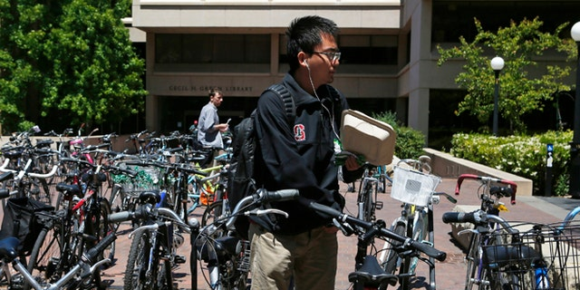 May 9, 2014: Students navigate a bicycle parking lot at Stanford University in Stanford, Calif.