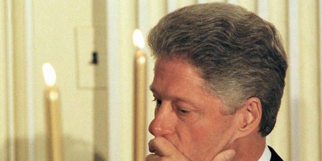 US President Bill Clinton waits his turn to speak at a dinner for the White House Endowment Fund January 21, 1998.
