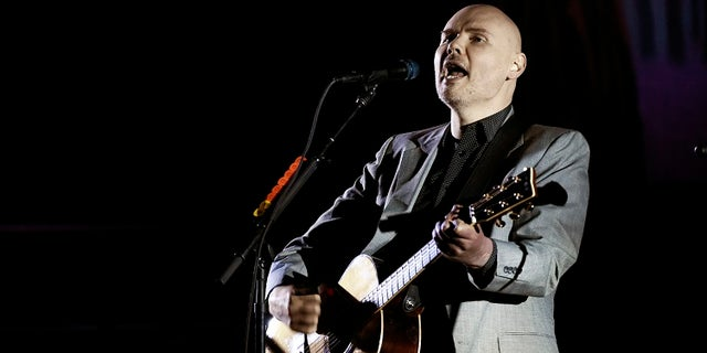 D'arcy Wretzky claims Billy Corgan (above) invited her to be part of the reunion but then rescinded the offer.
