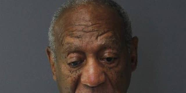 Bill Cosby takes booking photo after entering prison on Tuesday.