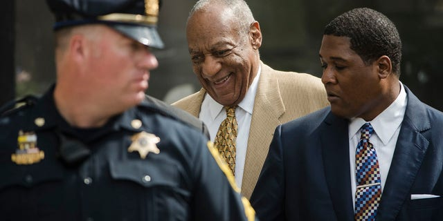 July 7, 2016: Bill Cosby, center, leaves a pretrial hearing in his criminal sex-assault case at Montgomery County Courthouse in Norristown, Pa