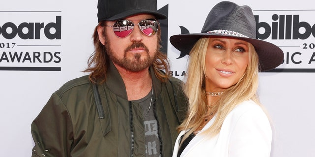 Billy Ray Cyrus, left, has fired Kirt Webster.
