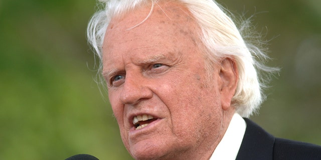 In this June 26, 2005 file photo, the Rev. Billy Graham speaks on stage on the third and last day of his farewell American revival.