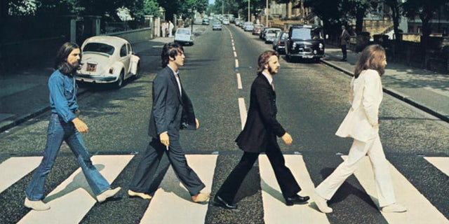 In Monday's video, McCartney strayed from donning the same dark suit he wore in the original photo.