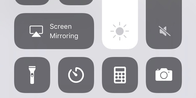 Adjust brightness manually by swiping up and moving the sun icon up and down.