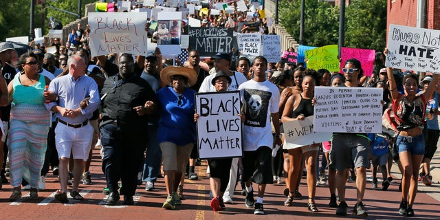 People march in a Black Lives Matter rally in Oklahoma City, Oklahoma.