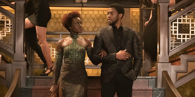 "This image released by Disney shows Lupita Nyong'o, left, and Chadwick Boseman in a scene from Marvel Studios' ""Black Panther."""