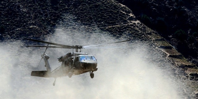 File photo - A U.S. Army Black Hawk helicopter lands at FOB Bostick in eastern Afghanistan's Naray district, Kunar province August 23, 2011. (REUTERS/Nikola Solic)