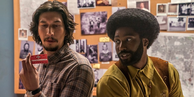 This image released by Focus Features shows Adam Driver, left, and John David Washington in a scene from 'BlacKkKlansman.'