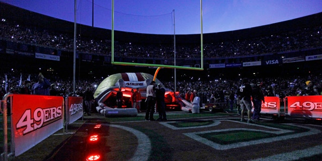 Dec. 19, 2011: Fans and officials wait in Candlestick Park stadium during a power outage before an NFL football game between the San Francisco 49ers and the Pittsburgh Steelers in San Francisco.