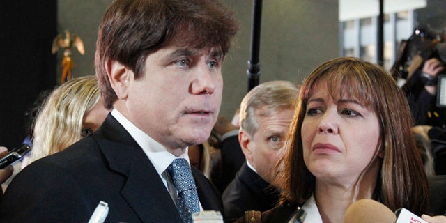 Dec. 7, 2011: Former Illinois Gov. Rod Blagojevich, left, speaks to reporters as his wife, Patti, listens at the federal building in Chicago, after Blagojevich was sentenced to 14 years on 18 corruption counts.