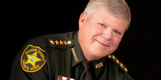 "Marion County Sheriff Chris Blair, who has said, ""If you are certified to carry a gun, I would like to encourage you to do so."""