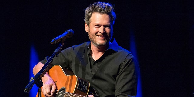 FILE - This June 7, 2016 file photo shows Blake Shelton performing at the 12th Annual Stars for Second Harvest Benefit at Ryman Auditorium in Nashville, Tenn. Shelton was named as People magazine's 2017 'Sexiest Man Alive.'
