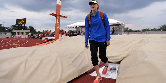 May 10, 2013: Emory Rains High School's Charlotte Brown, 15, gets a feel for the pole vault pit at the UIL State Track & Field meet in Austin, Texas.
