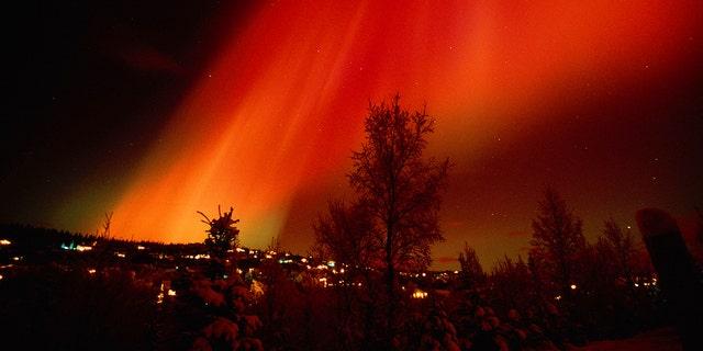 Red Aurora Over Hillside Residence Anchorage, Alaska, from February 2002